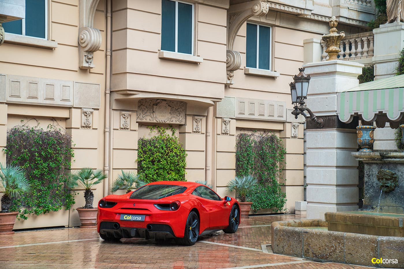 Red Ferrari 488 GTB outside Hotel Metropole in Monte Carlo
