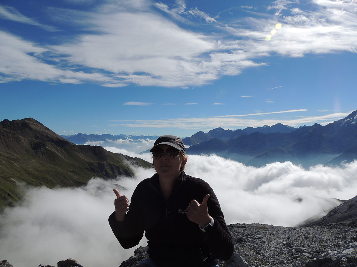 Alps Hiking above the clouds
